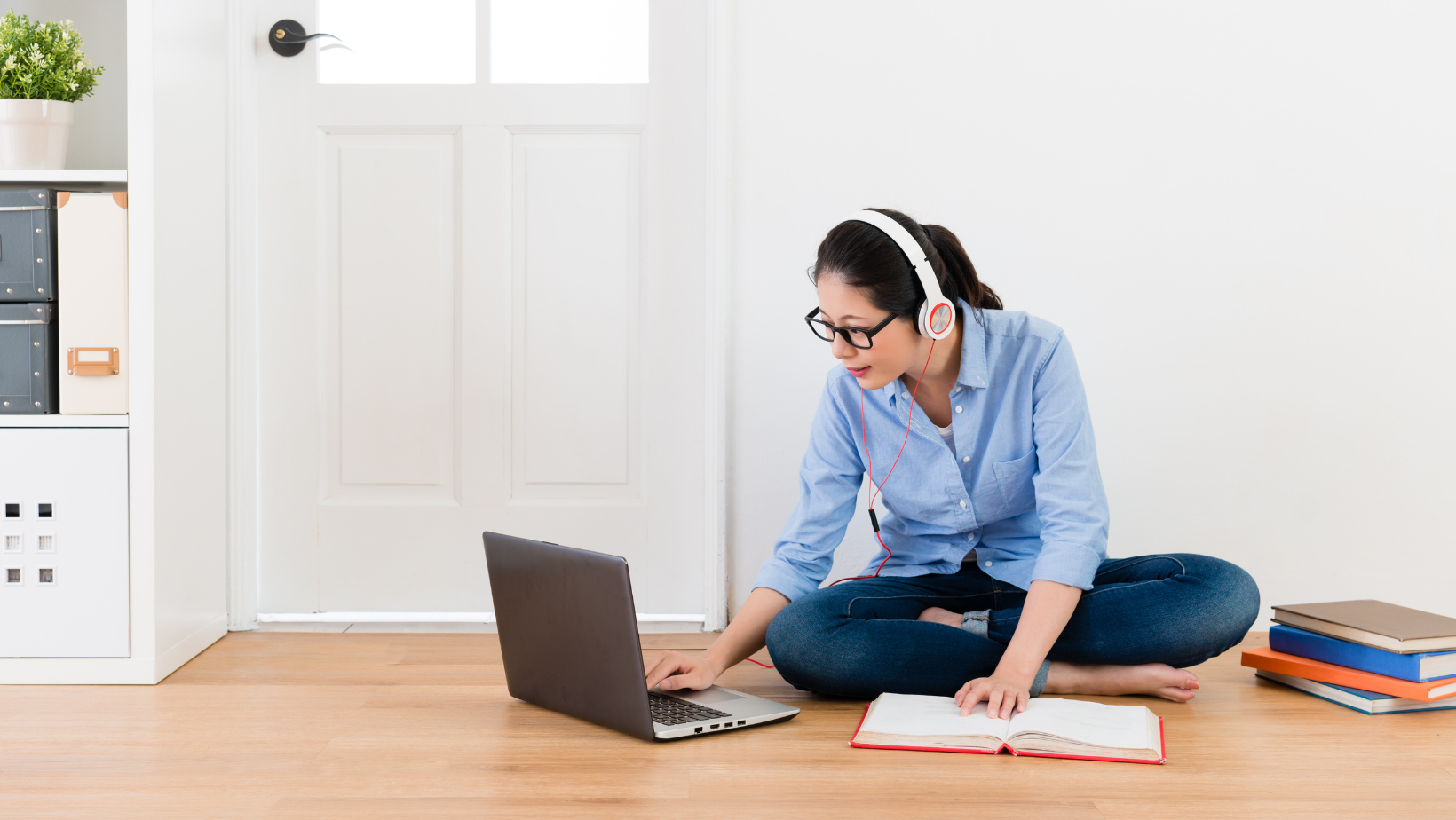 woman on the floor looking at a laptop